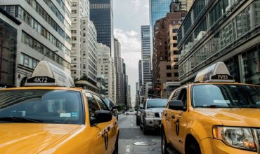 A street with cars in New York, representing how to compare moving companies in New York!